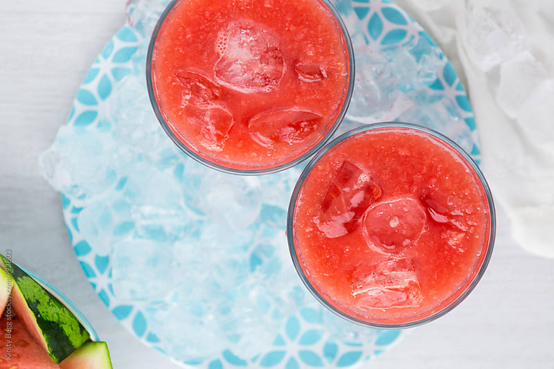 Iced watermelon smoothie juice in glasses by Kirsty Begg for Stocksy United