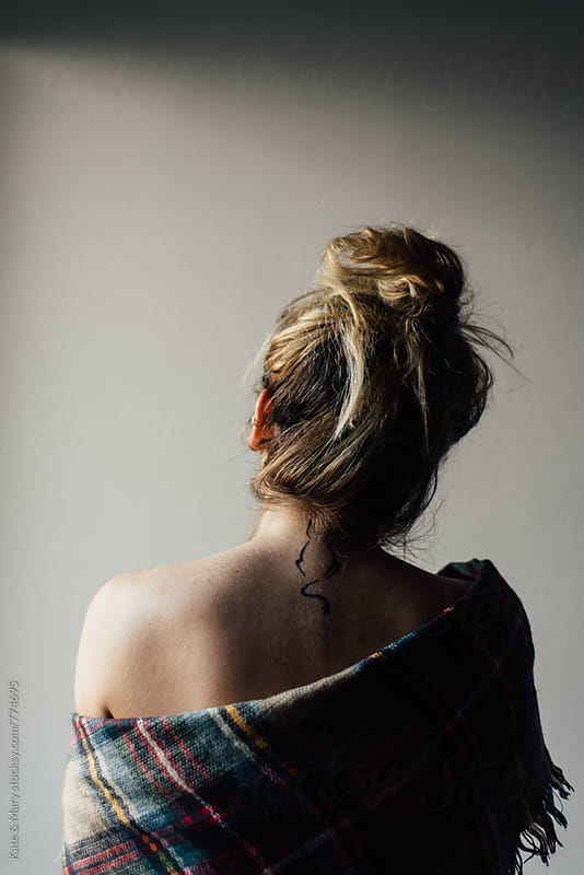 Back view of woman with cat tattoo by Katarina Simovic for Stocksy United
