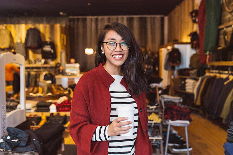 Smiling woman shopping by Carey Shaw for Stocksy United