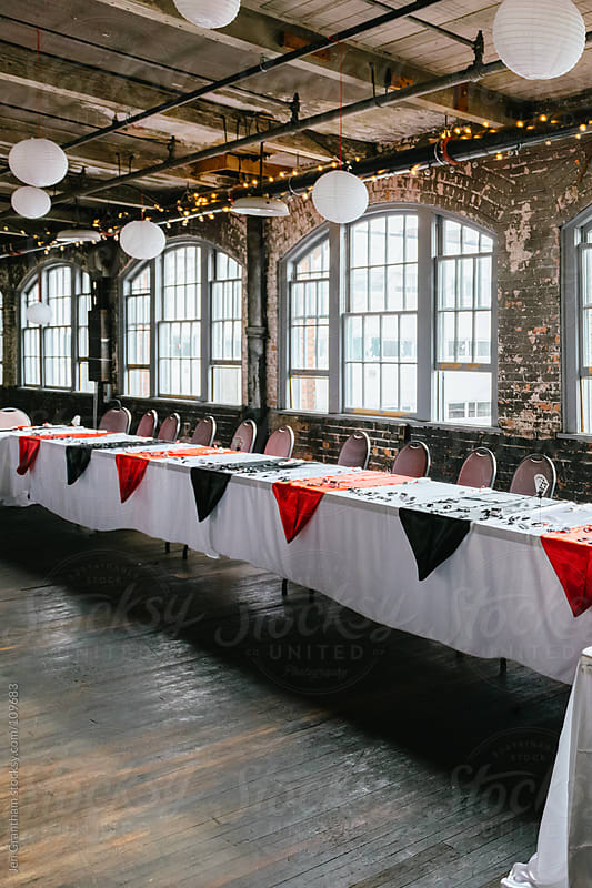 Head table at a building in an old warehouse by Jen Grantham for Stocksy United