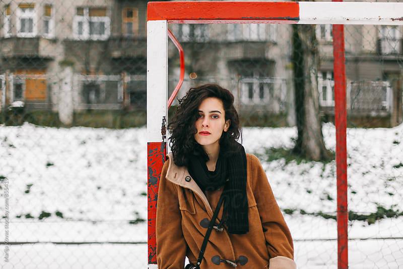 Beautiful brunette looking at camera  by Marija Kovac for Stocksy United