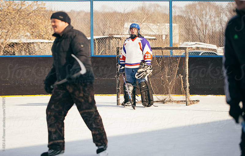 hockey in the yard by T-REX & Flower for Stocksy United