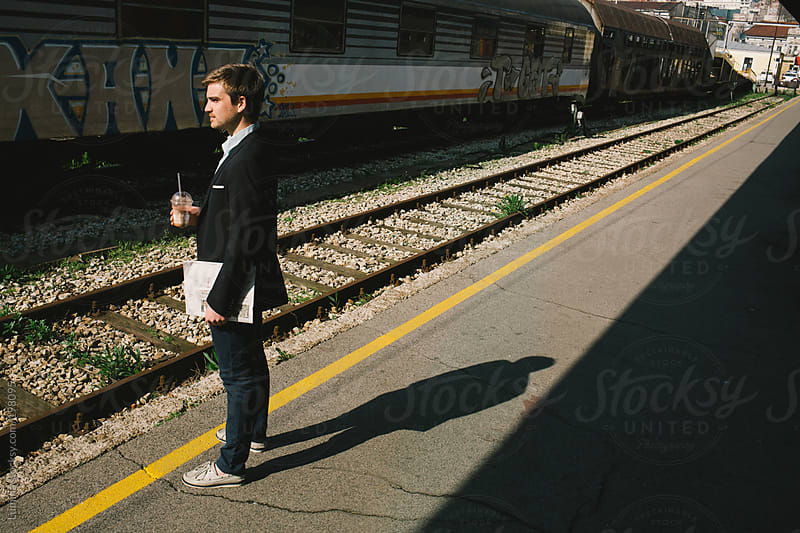 Businessman Waiting for the Train by Lumina for Stocksy United