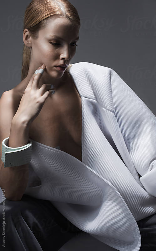 CLose up of sensual female model in white outfit/fashin series by Marko Milanovic for Stocksy United