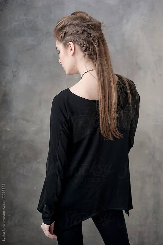 Young woman with braided hair by Lyuba Burakova for Stocksy United