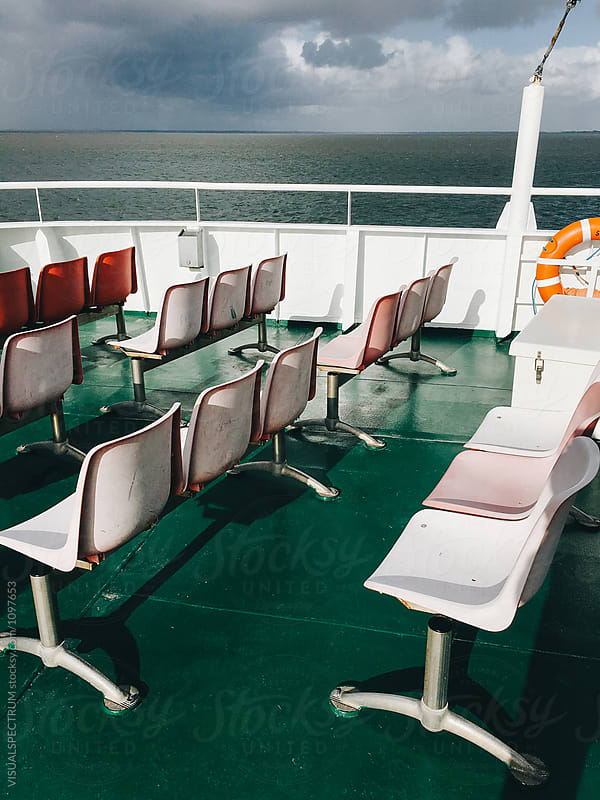 Empty Chairs on North Sea Ferry by Julien L. Balmer for Stocksy United