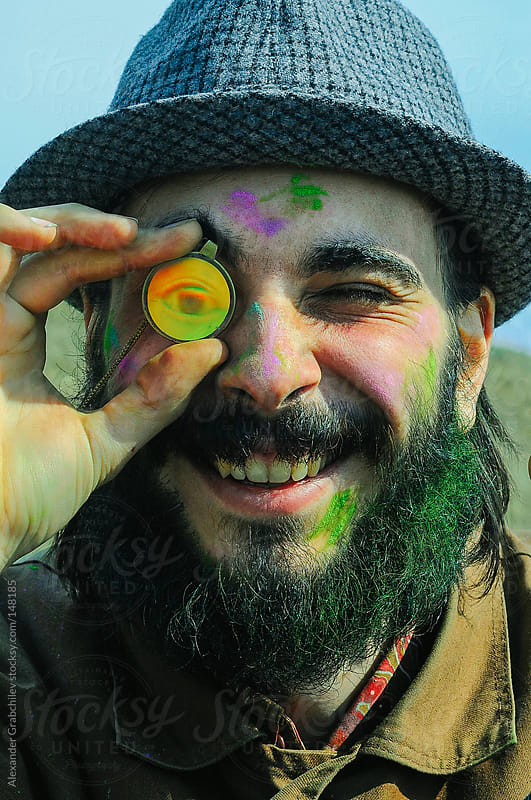 smiling beard man with rainbow eyeglass by Alexander Grabchilev for Stocksy United