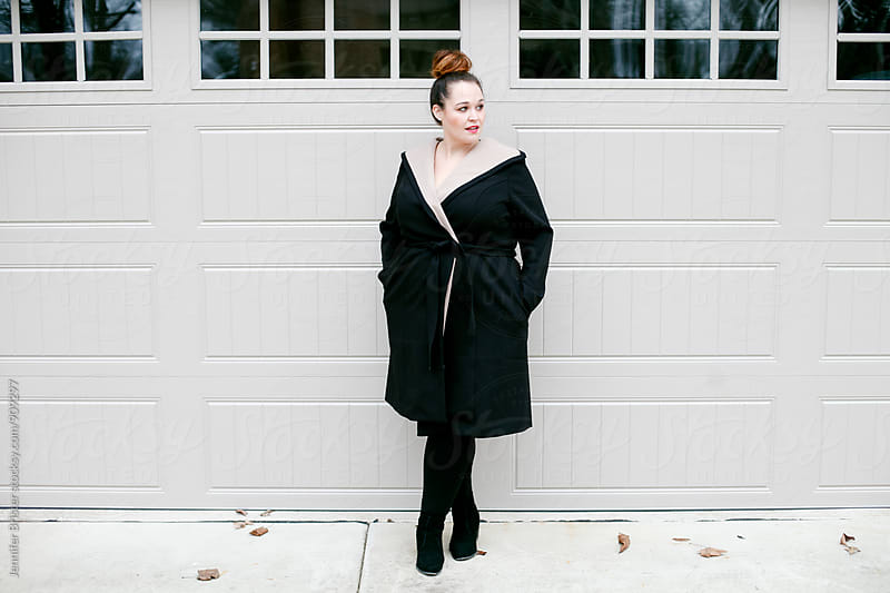 Beautiful woman in a winter coat by Jennifer Brister for Stocksy United