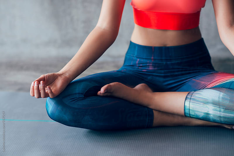 Fit Woman Meditating Indoors by Lumina for Stocksy United