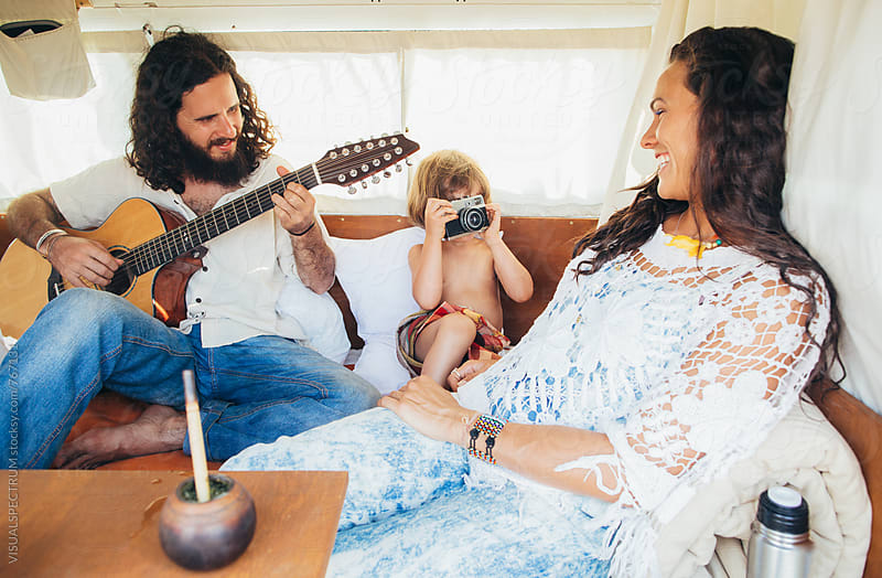 On The Road - Hippie Family of Three Enjoying Themselves in Camper Van by VISUALSPECTRUM for Stocksy United
