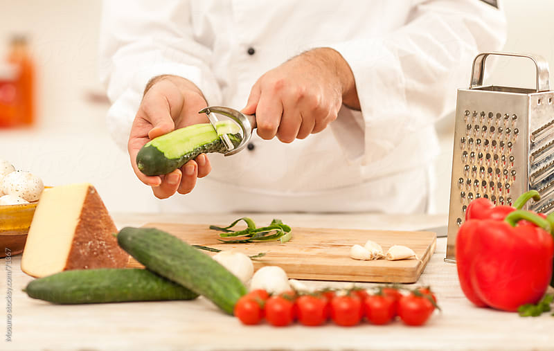 Chef preparing vegetables for cooking.  by Mosuno for Stocksy United