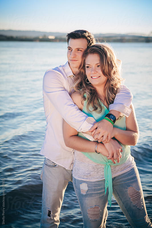 Couple at the waters edge by Shelly Perry for Stocksy United