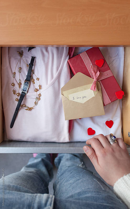Woman Standing by the Drawer with Valentine's Gifts by Mosuno for Stocksy United