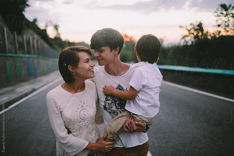 Family walking on the road by Evgenij Yulkin for Stocksy United