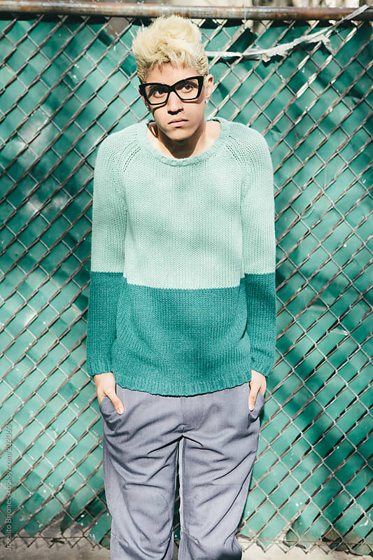Stylish Young Man with Bleached Blond Hair in Spring and Summer Fashion by Joselito Briones for Stocksy United