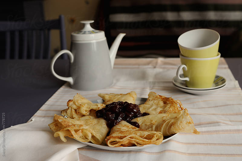 Plate with pancakes by Svetlana Shchemeleva for Stocksy United