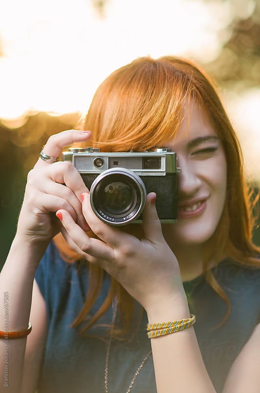 Portrait Of a Woman With Retro Camera by Brkati Krokodil for Stocksy United