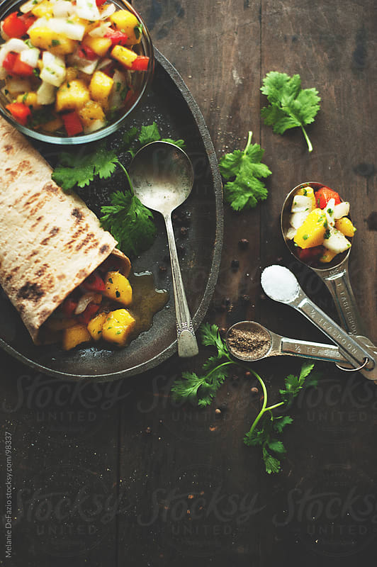 Mango Salsa Wraps by Melanie DeFazio for Stocksy United