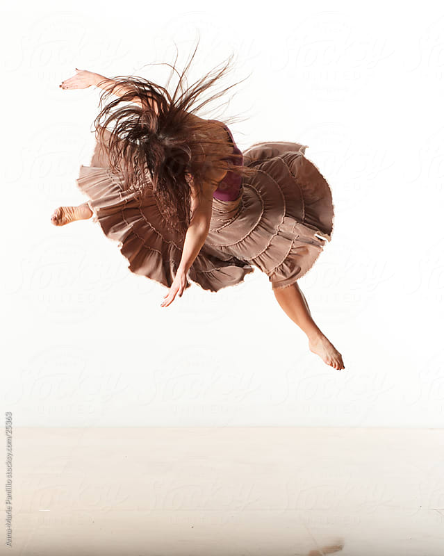 Female dancer in spinning jump by Anna-Marie Panlilio for Stocksy United