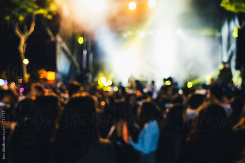 People at a concert at night - defocused by Inuk Studio for Stocksy United