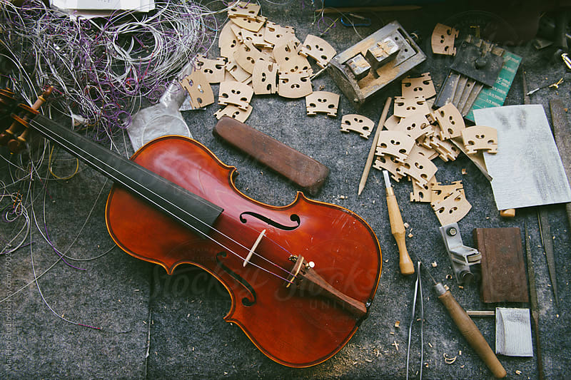 Tools and unfinished violin in a violin maker's workshop by Maa Hoo for Stocksy United