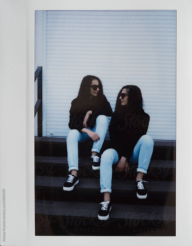 beautiful twins with round sunglasses by Vesna for Stocksy United