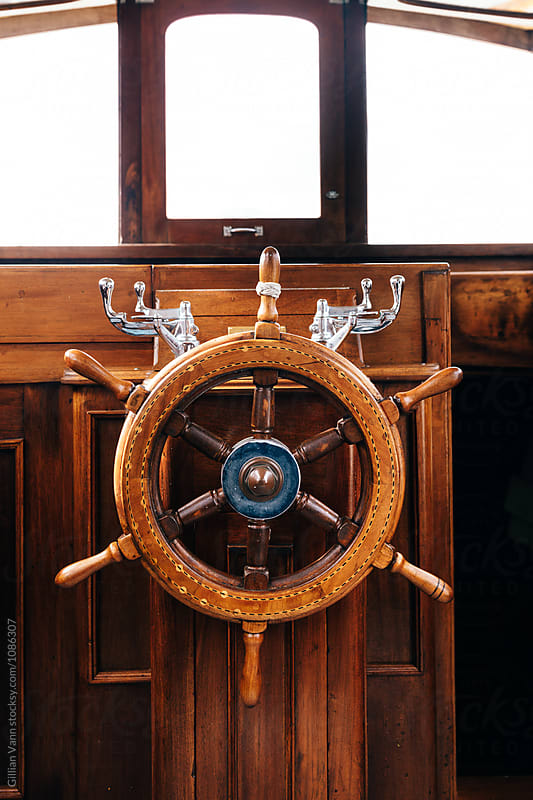 wooden helm on a boat by Gillian Vann for Stocksy United