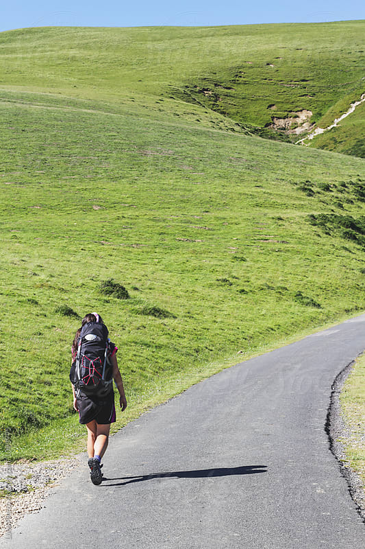 Pilgrim walking on Pyrenees the Camino de Santiago by Luca Pierro for Stocksy United