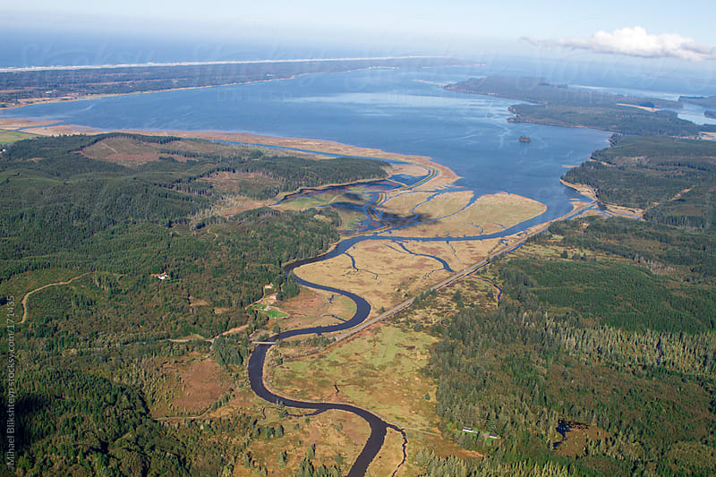 Aerial view of a Pacific Northwest river delta by Mihael Blikshteyn for Stocksy United