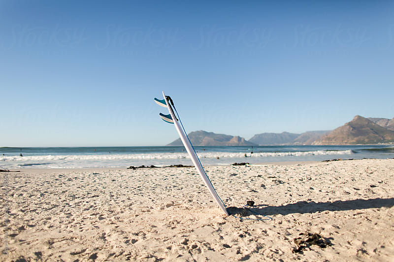 Surfboard on the beach on a summer day by Denni Van Huis for Stocksy United