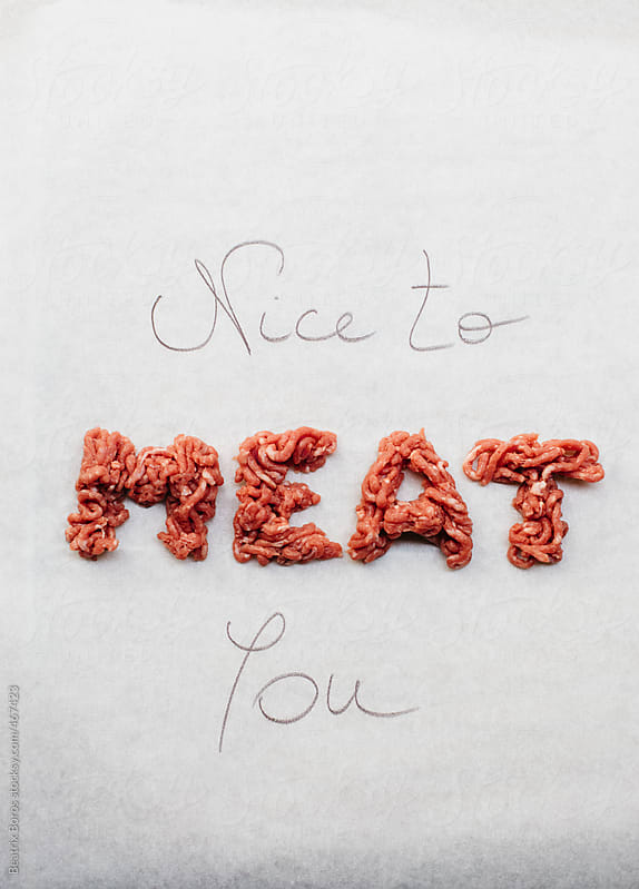 Funny nice to meat you written on white background with real meat by Beatrix Boros for Stocksy United