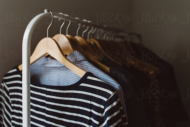 Striped dress hanging on clothing rack by Carey Shaw for Stocksy United