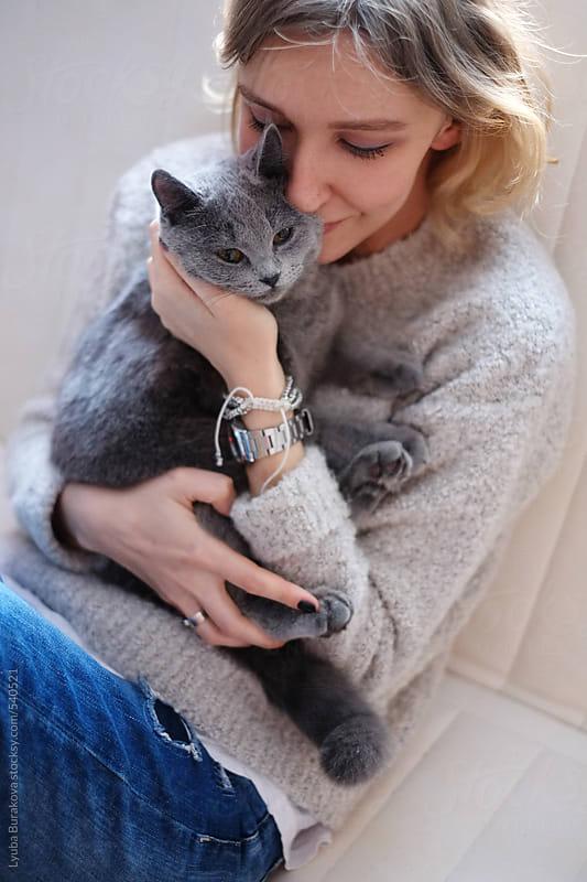 Woman in hug with her cat by Lyuba Burakova for Stocksy United