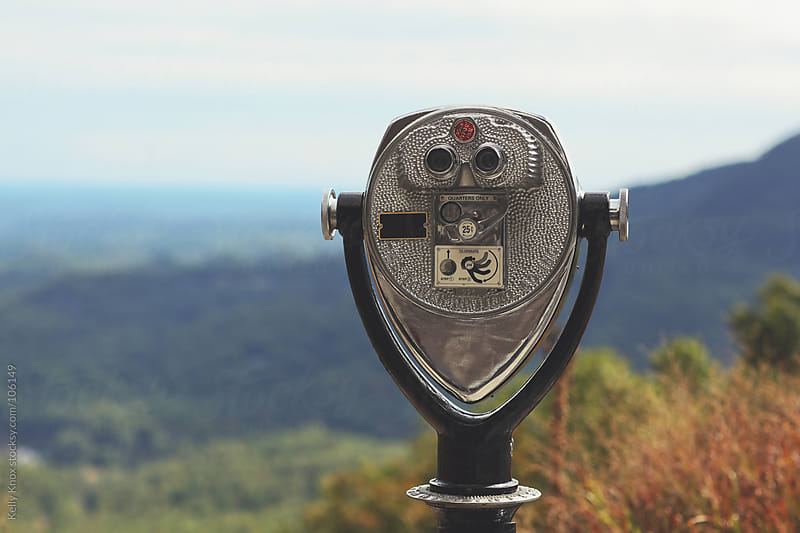 binoculars overlook the mountains by Kelly Knox for Stocksy United