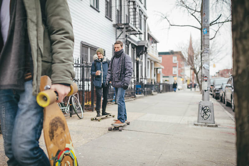 Group of Young Men with Skateboard in Brooklyn, New York City by Joselito Briones for Stocksy United