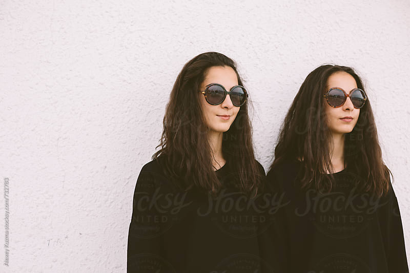 beautiful twins with round sunglasses by Alexey Kuzma for Stocksy United
