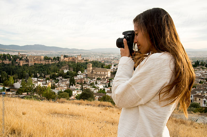 Woman taking pictures of the Alhambra views, Granada by Bisual Studio for Stocksy United