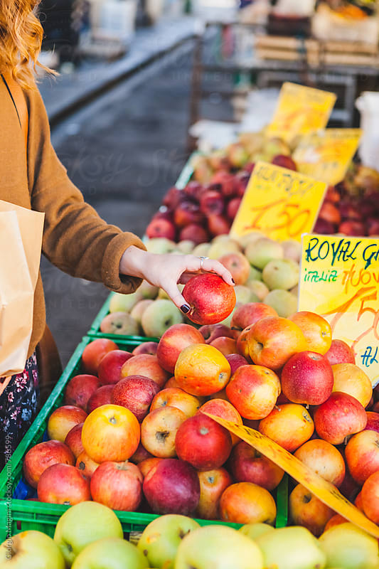 Choosing Apples to Buy at the Open Market by Giorgio Magini for Stocksy United