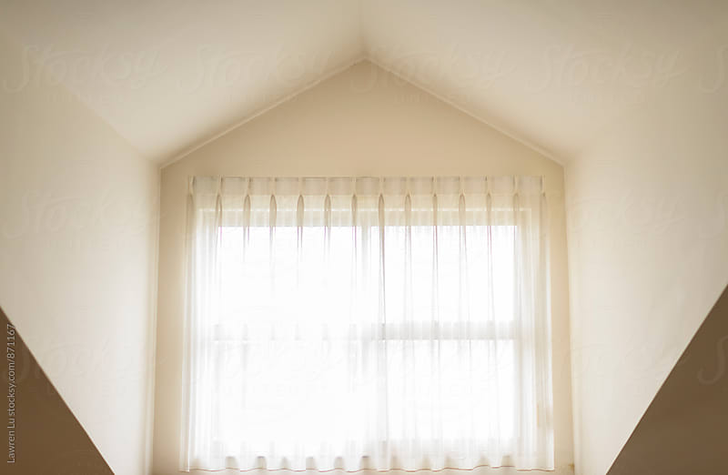 A window in the penthouse with sunshine by Lawren Lu for Stocksy United