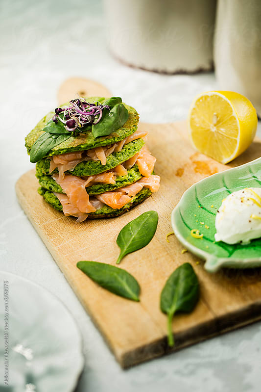 Blini with spinach and salmon by Aleksandar Novoselski for Stocksy United