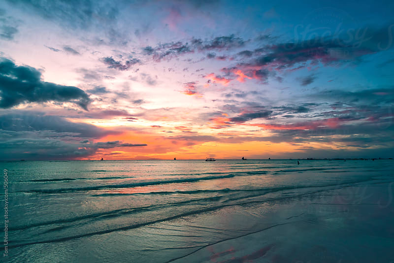 Sunset on White Beach in Boracay, the Philippines by Tom Uhlenberg for Stocksy United