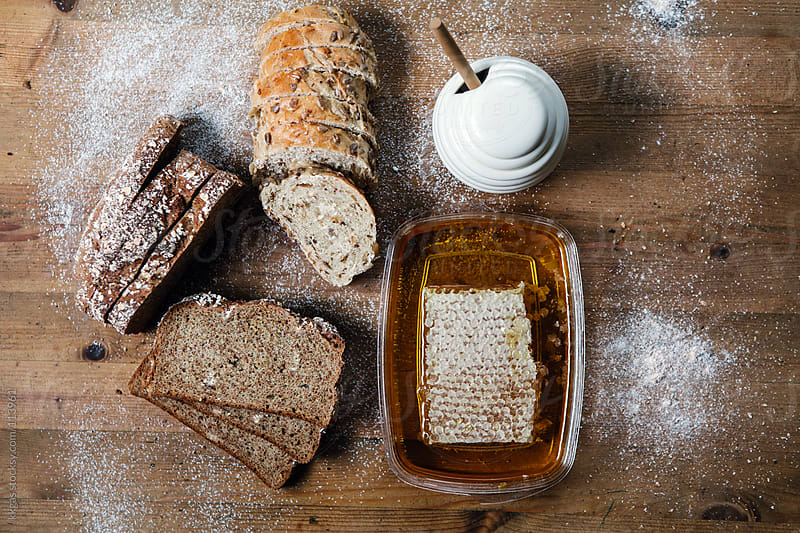 Bread and honeycomb by kkgas for Stocksy United