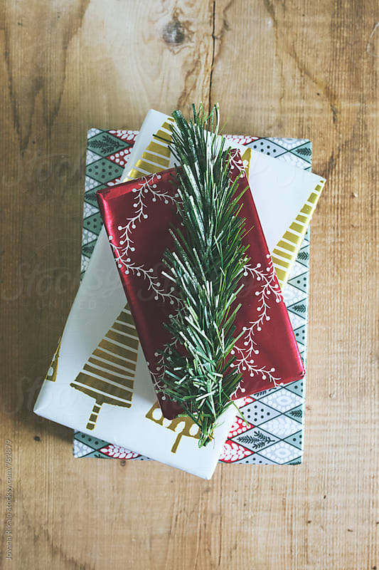 Christmas presents on a wooden background by Jovana Rikalo for Stocksy United