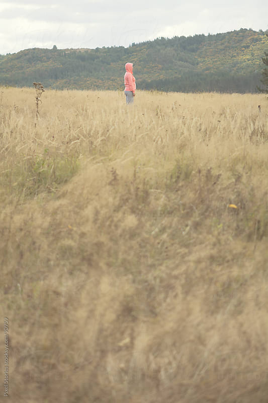 Woman standing in field by Pixel Stories for Stocksy United