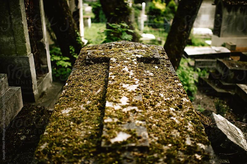 A moss covered tomb by Joseph West Photography for Stocksy United