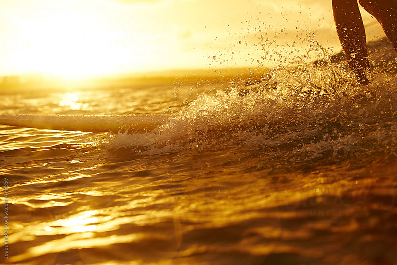 surfing in the sunset by Joaquim Bel for Stocksy United