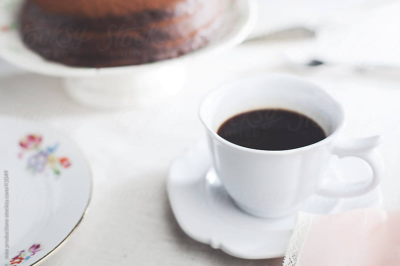 Coffe and chocolate cake for dessert. by mee productions for Stocksy United