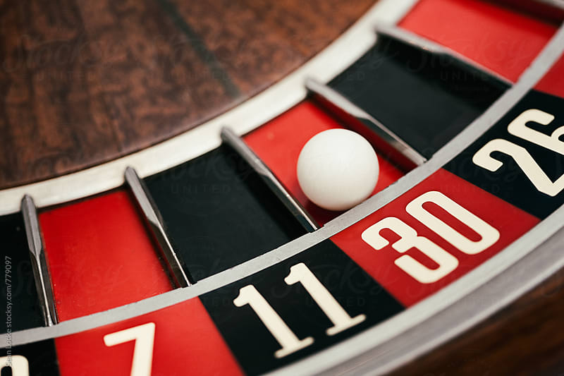 Casino: Ball Rests In 30 Slot On Roulette Wheel by Sean Locke for Stocksy United