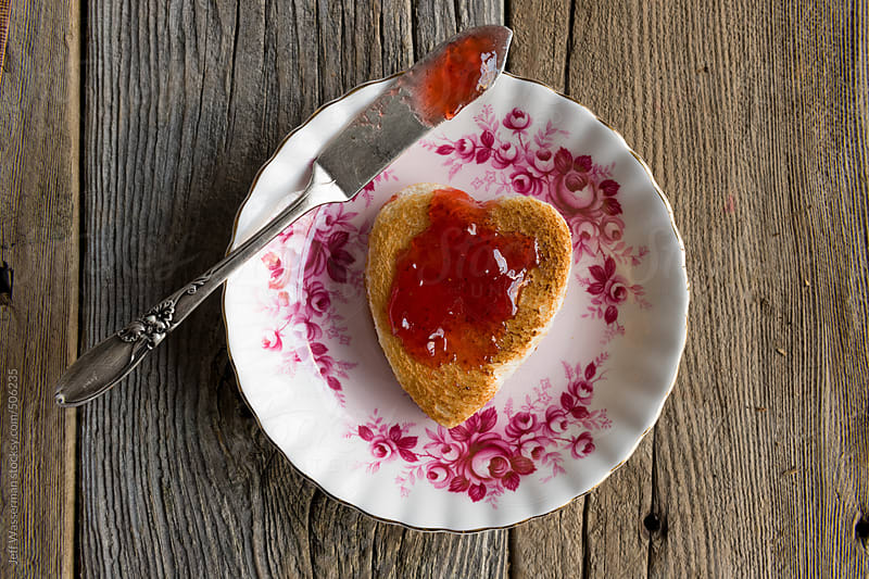 Heart Shaped Toast with Strawberry Preserves by Jeff Wasserman for Stocksy United