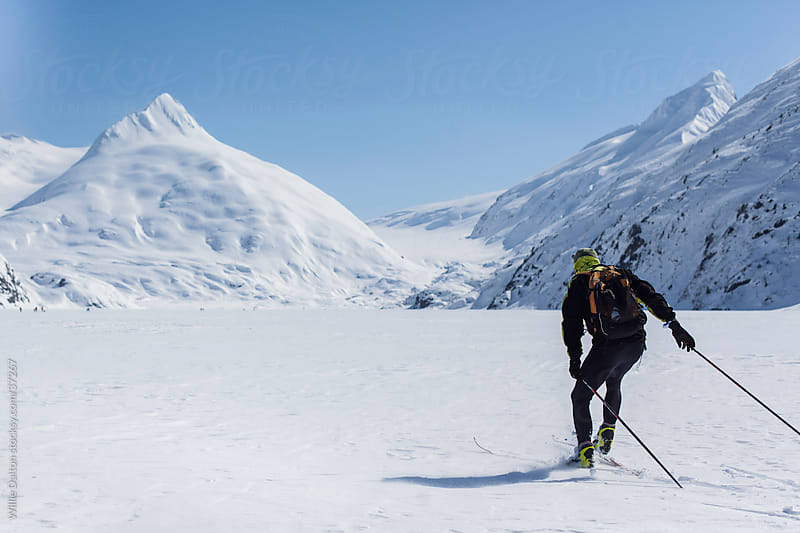 Man Skiing on a Frozen Lake by Willie Dalton for Stocksy United
